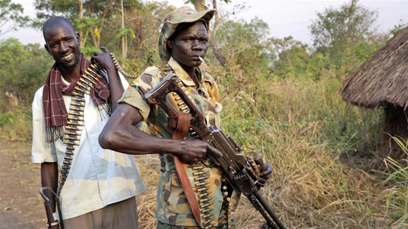 Opposition soldiers pose while loading their guns in Panyume town, the headquarters for the opposition in Central Equatoria state [File: Sam Mednick/AP]
