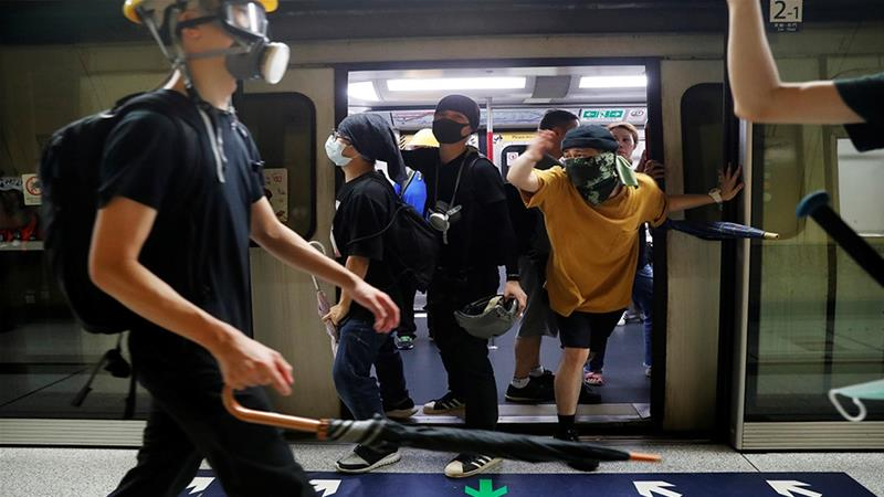 Hong Kong police charge 44 protesters with rioting