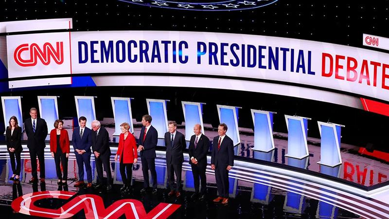 Ten of the Democratic 2020 US presidential candidates pose together before the start of the first night of the second Democratic debate [File: Lucas Jackson/Reuters]