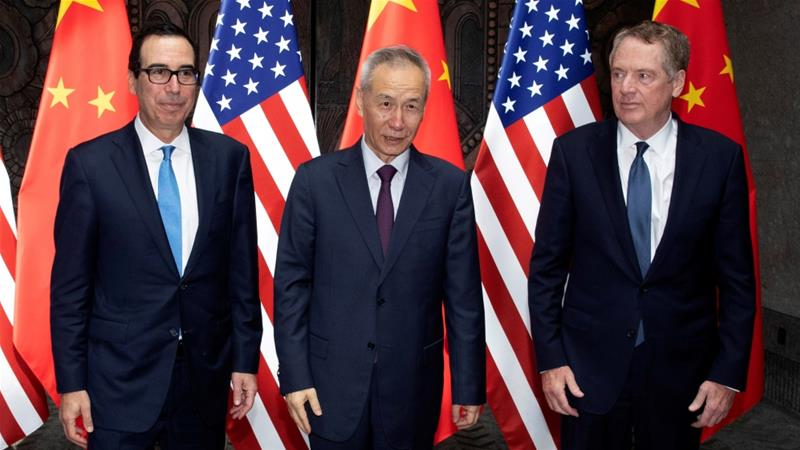 Chinese Vice Premier Liu He (centre) spoke over the phone with US Trade Representative Robert Lighthizer (right) and US Treasury Secretary Steven Mnuchin early Thursday [File: Ng Han Guan/Pool via Reuters]
