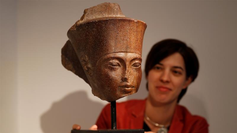 Slightly damaged at the ears and nose, the sculpture came from the private Resandro Collection of Egyptian art [Peter Nicholls/Reuters]