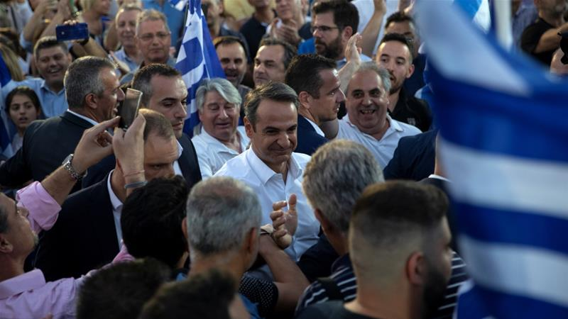 Main opposition New Democracy party leader Kyriakos Mitsotakis is welcomed by supporters during a pre-election rally in Athens [Alkis Konstantinidis/Reuters]