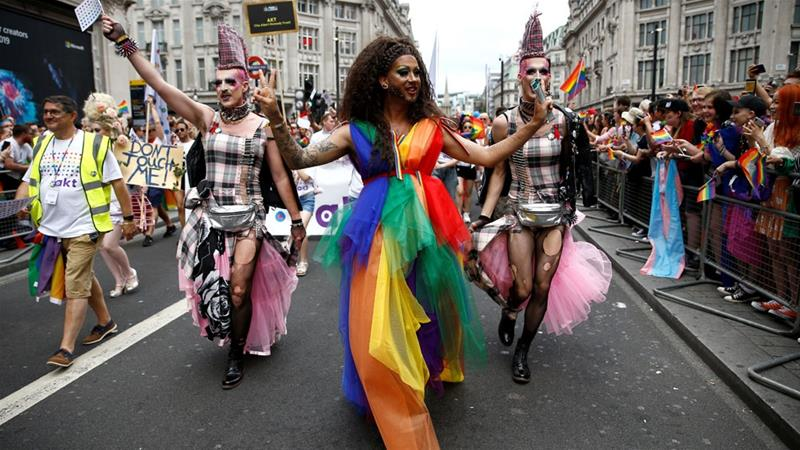 Participants take part in the annual Pride in London parade [Henry Nicholls/Reuters]