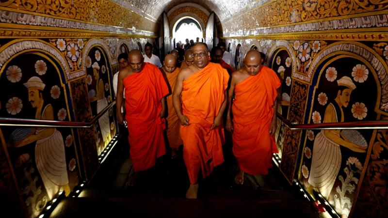 Gnanasara visited one of Buddhism's most sacred temples in Kandy on Sunday before heading to the gathering [Dinuka Liyanawatte/Reuters]