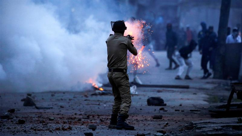 An Indian police officer fires a tear gas shell during a protest in Srinagar last year [File: Danish Ismail/Reuters]