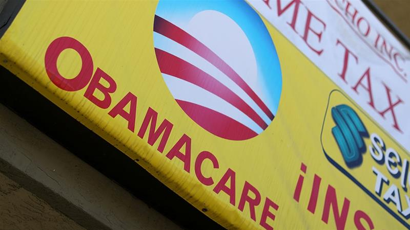 A sign on an insurance store advertises Obamacare in San Ysidro, San Diego, California [Mike Blake/Reuters]