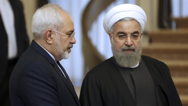 Rouhani, right, listens Zarif prior to a meeting in Tehran, Iran [File: Vahid Salemi/AP Photo]