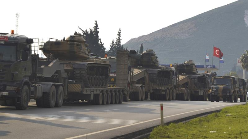 A convoy of Turkish military trucks destined for Syria seen in Hatay province, southeastern Turkey, near the border with Syria, January 14, 2019 [File: Mehmet Kocacik/DHA via AP]