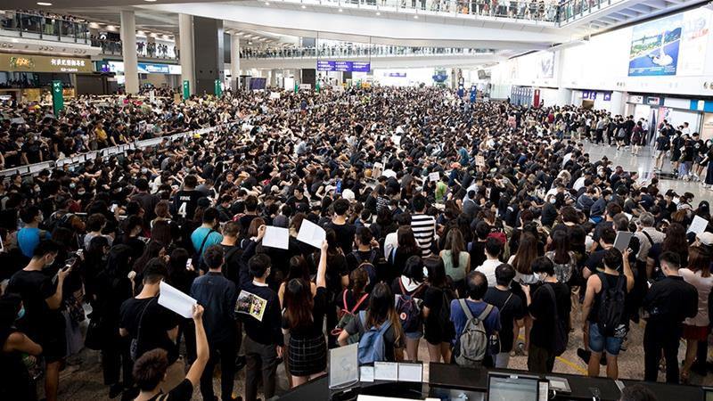 Hong Kong airport cancels Monday flights amid sit-in protest
