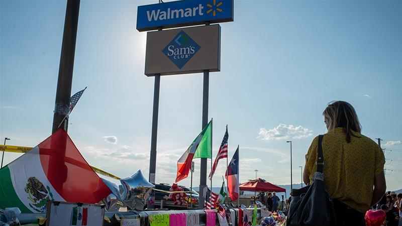 Following a mass shooting at a Walmart store in El Paso, Texas and a shooting at a Walmart in Southaven, Mississippi, the largest retailer in the United States is facing criticism for allowing the sale of pro-gun tee-shirts on its website [File: Luke E. Montavon/Bloomberg]