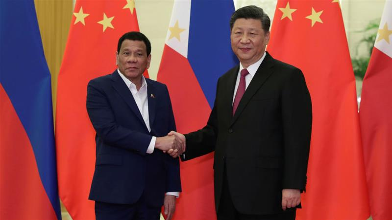 Duterte's closeness to Chinese President Xi Jinping (right) concerns Filipinos afraid of losing territorial and maritime rights [Kenzaburo Fukuhara/Pool/Reuters]