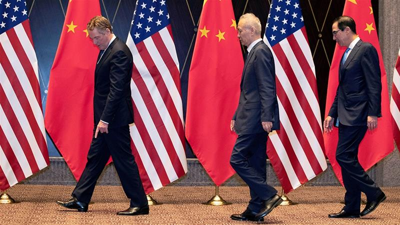 US Trade Representative Robert Lighthizer (left), Chinese Vice Premier Liu He (centre) and US Treasury Secretary Steven Mnuchin (right) are due to meet on October 10 to begin ministerial-level trade negotiations [File: Ng Han Guan/Reuters]