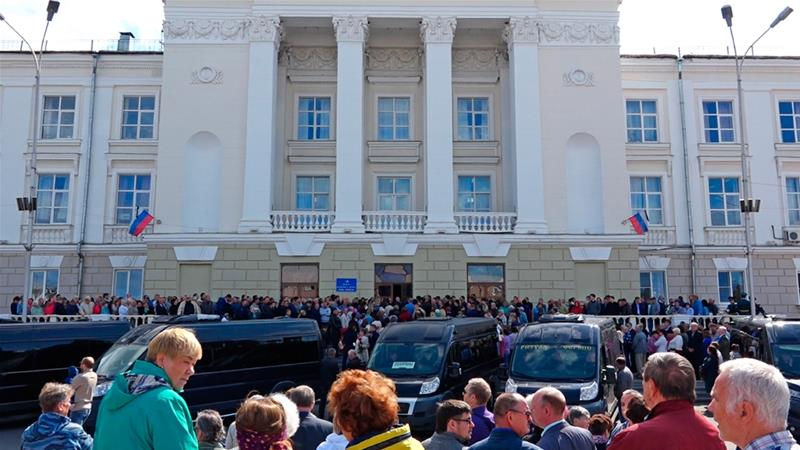 Thousands of people attend the burial of five Russian nuclear engineers killed by an explosion [Russian State Atomic Energy Corporation ROSATOM via AP]