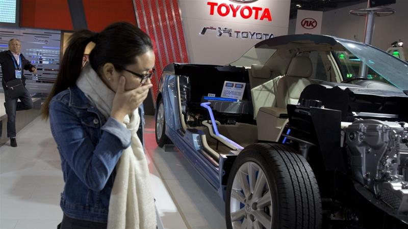 Purchases of electric and hybrid cars fell 4.7 percent from a year ago to 80,000 units in July [File: Ng Han Guan/AP]