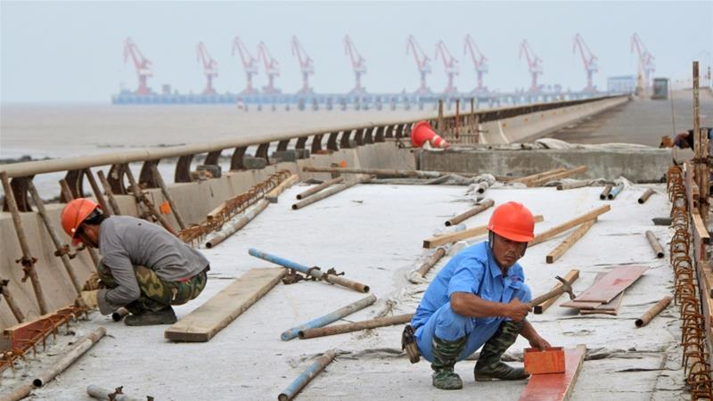 China's economy weakens in July as industrial growth stalls