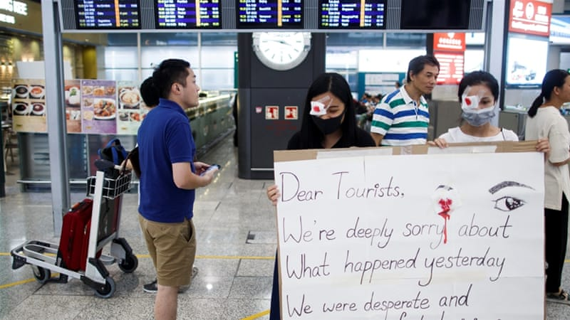 HK protesters apologise after airport chaos, take day to regroup