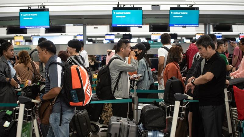 Hong Kong airport reopens as order to remove protesters looms
