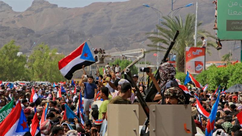 Supporters of Yemen's southern separatists waved flags of the old state of South Yemen at a rally in Aden [Fawaz Salman/Reuters]