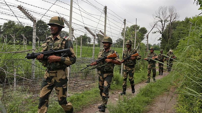 Indian soldiers patrolling near the LoC on Tuesday [Channi Anand/AP Photo]