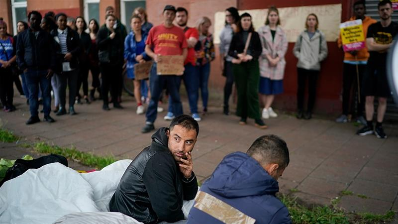 Afghan refugee Rahman Sahah, right, and Mirwais Ahmadzai went on hunger strike last year in Glasgow after they faced eviction by social housing provider Serco [File: Christopher Furlong/Getty Images]