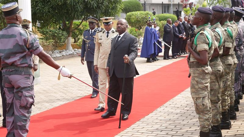 Gabonese President Ali Bongo (C) attends a wreath-laying ceremony in Libreville [Steve Jordan/AFP]
