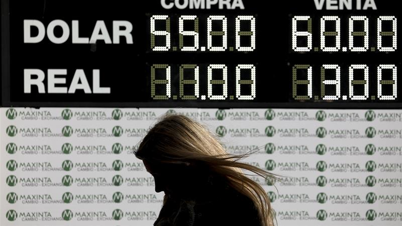 On August 16, Fitch Ratings became the first international ratings agency to downgrade Argentina's sovereign debt rating from 'B' to 'CCC', suggesting an increased likelihood of default [File: Natacha Pisarenko/AP]