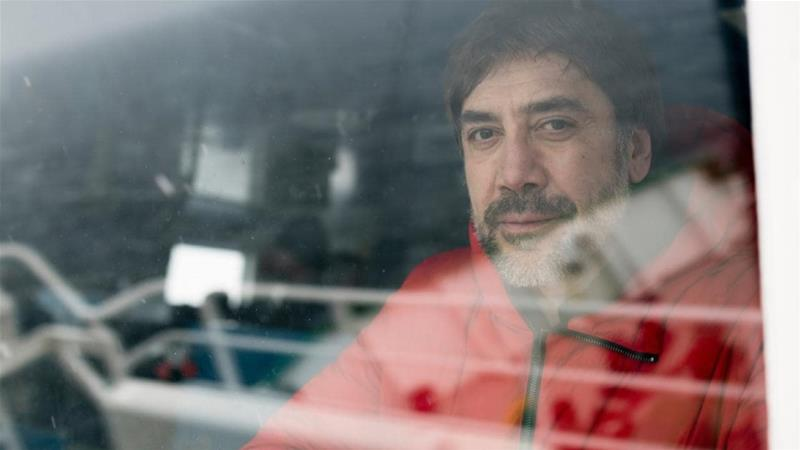 Actor Javier Bardem on the bridge with the ocean reflecting in the window, on board the Greenpeace ship Arctic Sunrise in the Gerlache Strait, Antarctic, January 24, 2018 [Christian Aslund/Greenpeace]