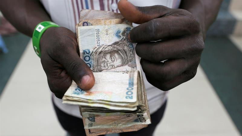 Nigeria's currency, the naira, has faced downward pressures from weak oil prices and falling bond yields [Nyancho NwaNri/Reuters]