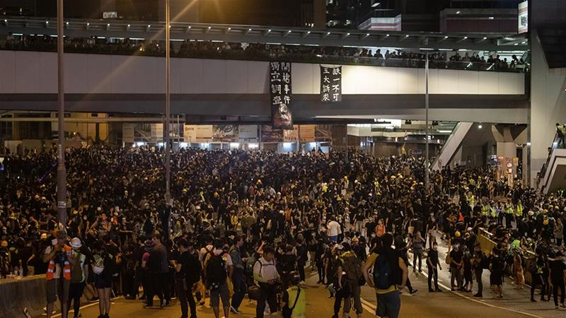 Twitter and Facebook, two US-based tech and social media companies, said they have removed accounts from their respective platforms that were part of a 'coordinated and state-backed operation' against Hong Kong's protesters [Kyle Lam/Bloomberg]