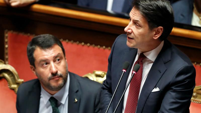 Far-right figurehead Matteo Salvini (left) listens as Italian PM Giuseppe Conte addresses the Senate in Rome [Yara Nardi/Reuters]