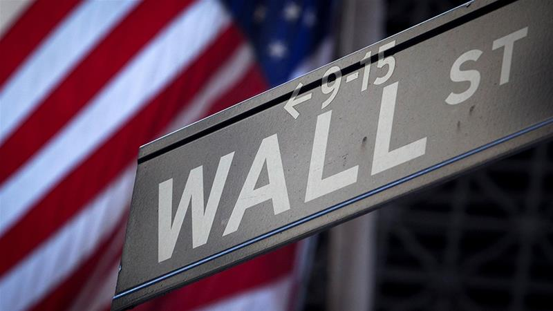 The US Office of the Comptroller of the Currency and the Federal Deposit Insurance Corporation both approved a revamped version of the Volcker Rule, which aims to ban lenders that accept US taxpayer-insured deposits from engaging in proprietary trading [Carlo Allegri/File/Reuters]