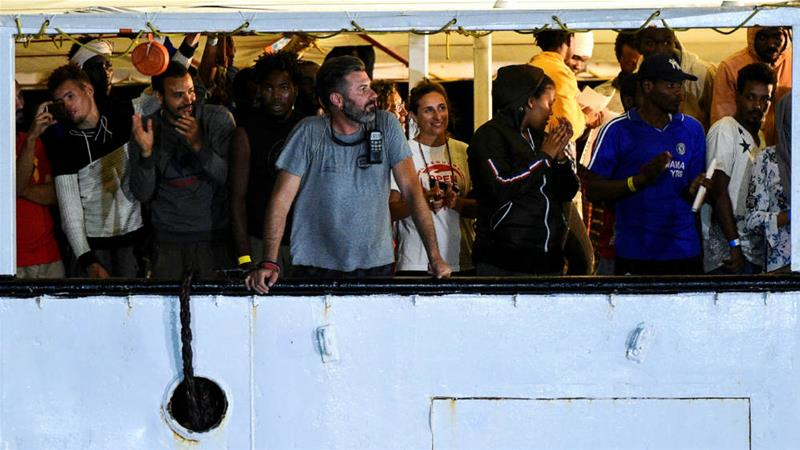 Spanish rescue ship Open Arms arrives in the Italian port of Lampedusa on Tuesday night [Guglielmo Mangiapane/Reuters]