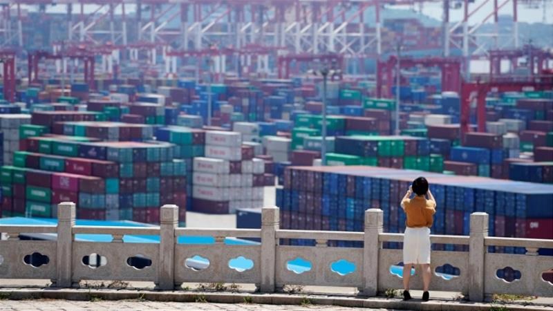 Chinese and US negotiators have been keeping in touch with each other to discuss their trade dispute, says China's commerce ministry [File: Aly Song/Reuters]