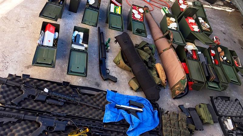 This undated photo released on August 21, 2019, by the Long Beach, California Police Department shows weapons and ammunition seized from a cook at a Los Angeles-area hotel [Handout/Long Beach Police Department/AP Photo]