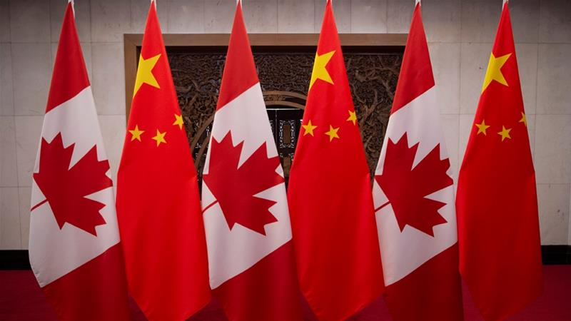 Relations between China and Canada have soured since Canada arrested a senior Huawei executive in compliance with a US arrest warrant in December [Fred Dufour/Reuters]