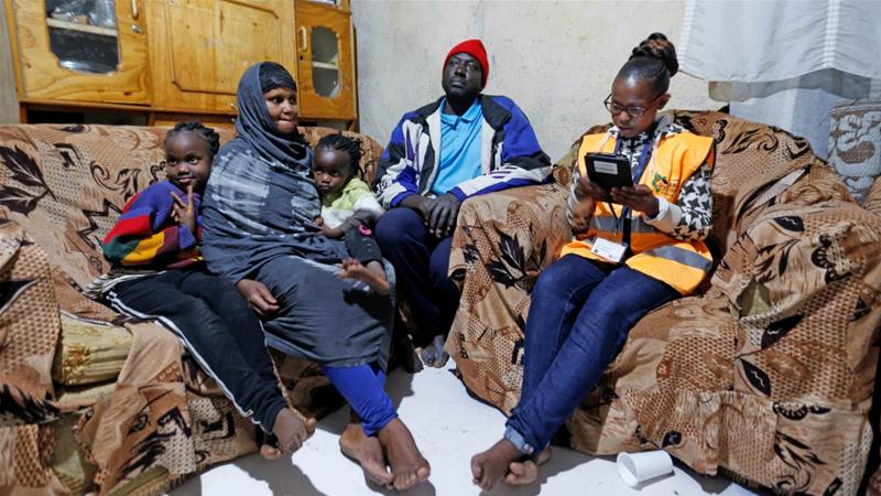 An enumerator records details of a family participating in the 2019 Kenya Population and Housing Census at the Kibera slum in Nairobi on August 24, 2019 [Reuters/Thomas Mukoya]