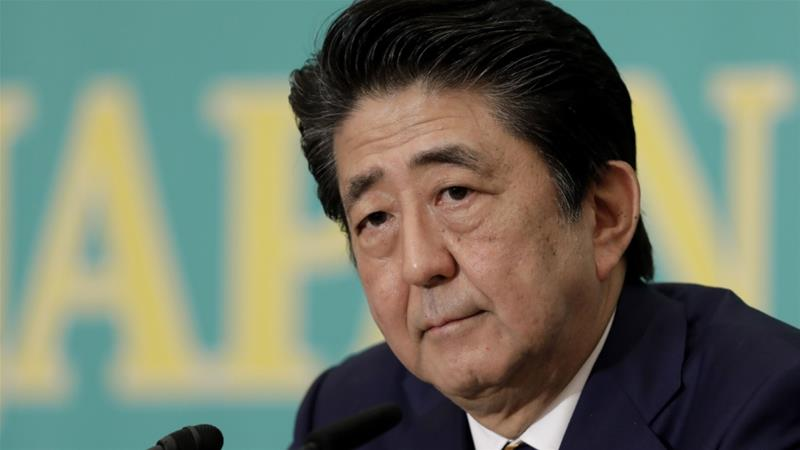 Despite criticism that terms were unfair to Japan, Prime Minister Shinzo Abe has defended the limited trade deal he signed with US President Donald Trump in October [File: Kiyoshi Ota/Bloomberg]
