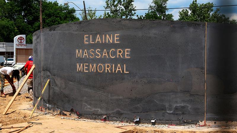 In this June 15, 2019, photo, men work near a monument under construction honouring victims of the Elaine massacre that sits across from the Phillips County court in Helena, Arkansas [File: Noreen Nasir/AP]