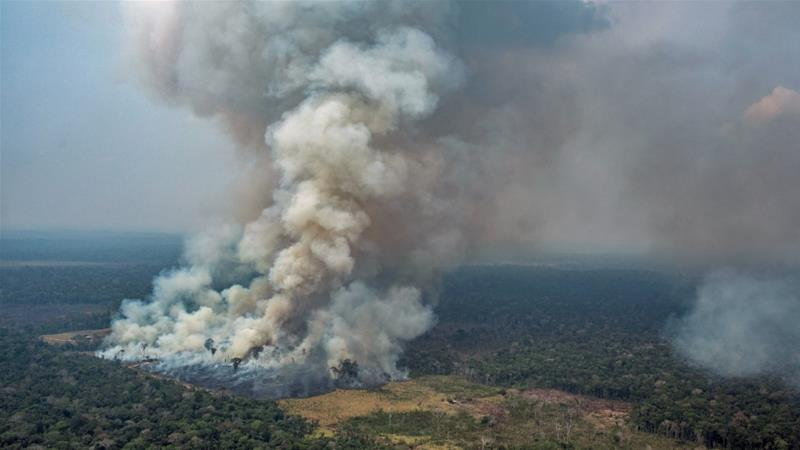 The Group of Seven developed nations has pledged $40m to fight wildfires in the Amazon but Brazilian President Jair Bolsonaro accused rich countries of angling to exploit Brazil's natural resources [File: Victor Moriyama/Greenpeace/AFP]