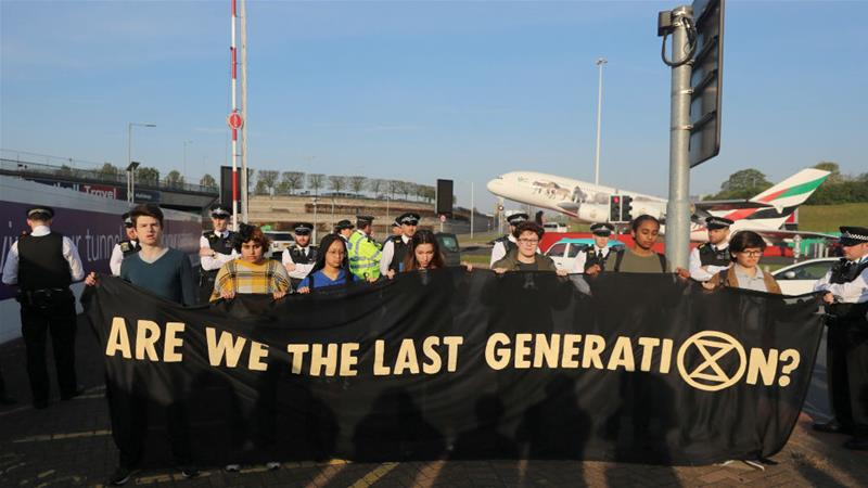 Climate change activists at an Extinction Rebellion protest outside Heathrow airport in April 2019 [File: Simon Dawson/Reuters]