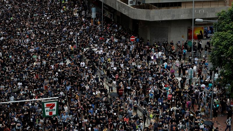 Protests grip Hong Kong district amid fears of police brutality