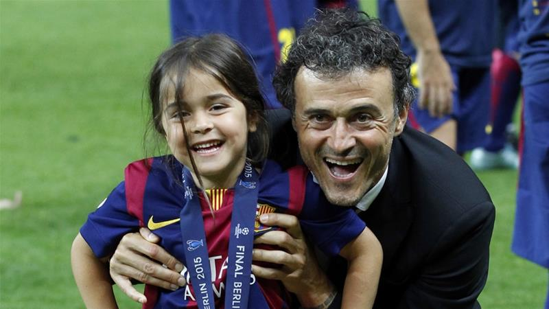 Luis Enrique and his daughter Xana celebrated after Barcelona won the Champions League final in 2015 [File: Michael Probst/AP]