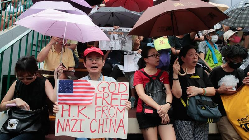 Hong Kong protesters target airport but planes are running