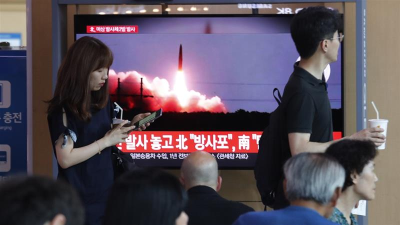 The Yonhap news agency in South Korea said the projectiles flew 450km and reached an altitude of 37km [Ahn Young-joon/AP]