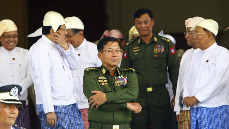 Gen Min Aung Hlaing, centre, is Myanmar's most senior army commander [Aung Shine Oo/AP]