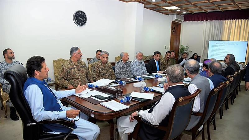 Imran Khan chaired a meeting of Pakistan's National Security Council on Kashmir on Wednesday [Handout from Pakistan Prime Minister's Office via AFP]