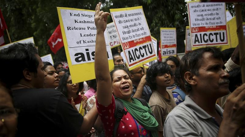 Indian activists and others shout slogans during a protest against Indian government revoking Kashmir's special constitutional status in New Delhi, India [Altaf Qadri/AP Photo]