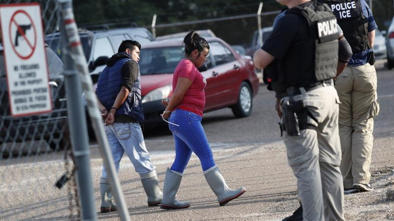 Those arrested were taken to a military hangar to be processed for immigration violations [Rogelio V Solis/AP]