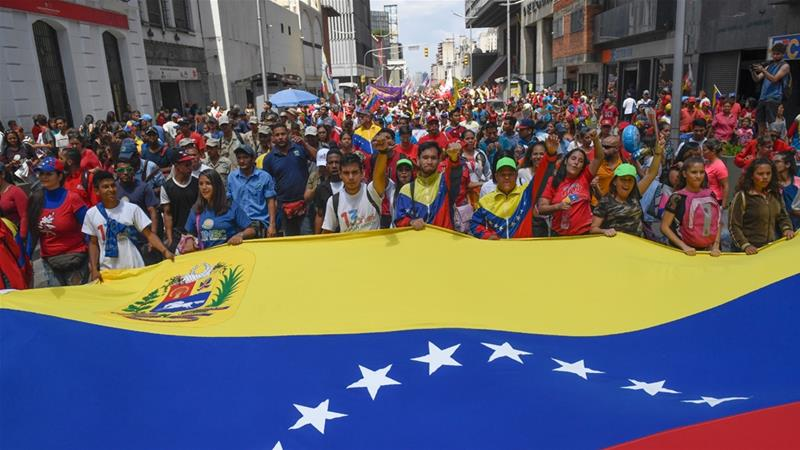 Government supporters in the capital, Caracas, protest against the US sanctions [Federico Parra/AFP]