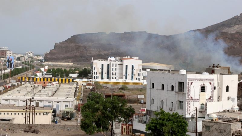 Sounds of gunfire echoed through the southern port city while smoke and fire could be seen rising from the Jebel Hadid area, part of the Crater district that houses the hilltop presidential palace [Fawaz Salman/Reuters]